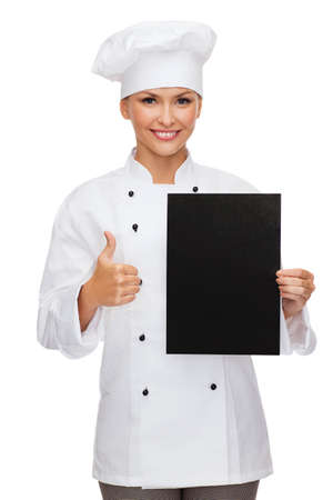 cooking, advertisement and food concept - smiling female chef, cook or baker with blank black paper showing thumbs up Stock Photo - 25849851
