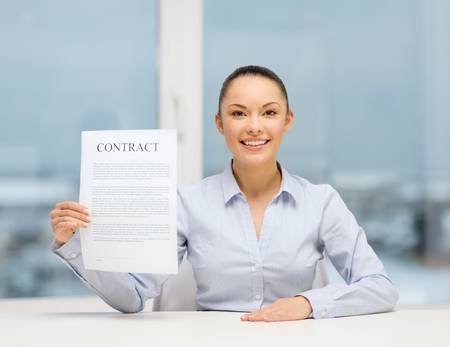 business, education, school, documents, people, legal and real estate concept - happy businesswoman holding contract in office