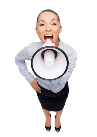 business and office concept - screaming businesswoman with megaphone photo