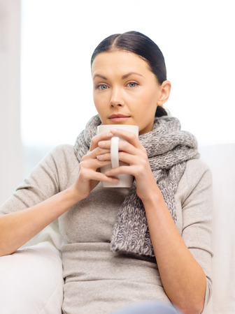 healthcare, home and medicine concept - ill woman with flu at home photo