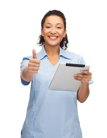 healthcare, technology and medicine concept - smiling female african american doctor or nurse tablet pc computer showing thumbs up photo