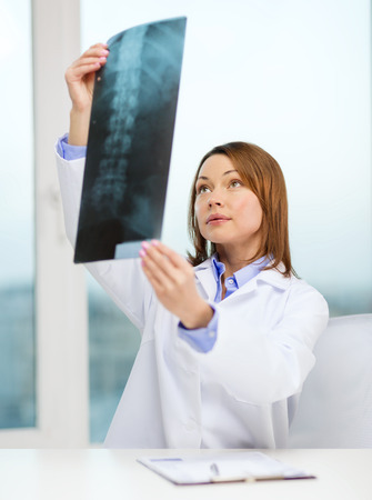 concetrated: healthcare, medical and radiology concept - concentrated doctor looking at x-ray Stock Photo