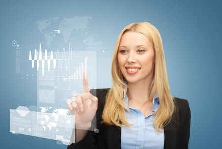 business and future technology concept - beautiful young businesswoman working with virtual screen photo