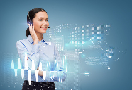 contact center: business and office concept - friendly female helpline operator with headphones