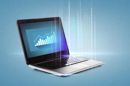 technology and advertisement concept - laptop computer with graph on desktop photo