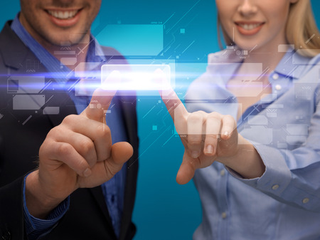business and future technology concept - man and woman hands pointing at virtual screen photo