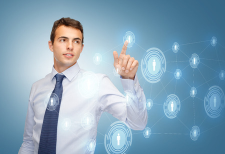 business, technology, communication concept - businessman working business network on imaginary virtual screen photo