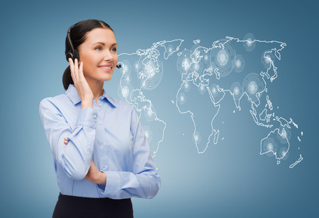 media center: business and office concept - friendly female helpline operator with headphones