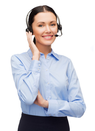 call center agent: business and office concept - friendly female helpline operator with headphones