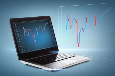 yen note: technology, money and investment concept - laptop computer with forex chart on desktop
