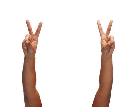 gesture and body parts concept - woman hands showing v-sign photo