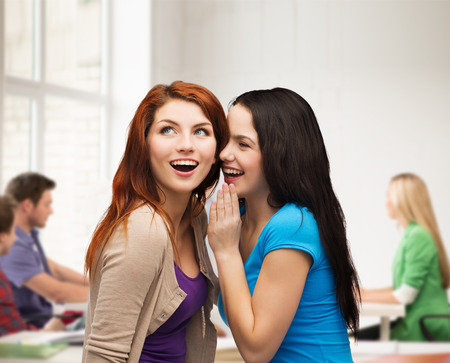 blab: friendship, happiness and education concept - two smiling girls whispering gossip