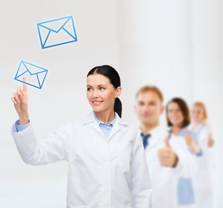 healthcare, medicine and technology concept - smiling female doctor pointing to envelope Stock Photo - 26176138