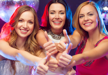 celebration, friends, bachelorette party and birthday concept - three smiling women showing thumbs up photo