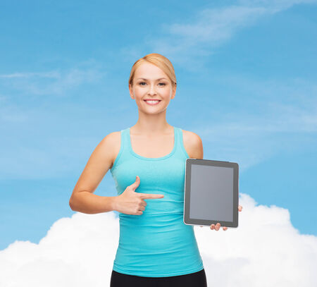 sport, excercise, technology, internet and healthcare - sporty woman with tablet pc blank screen photo
