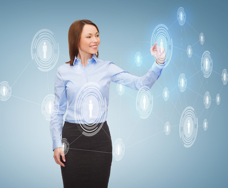 business and future technology concept - young businesswoman working with virtual screen photo