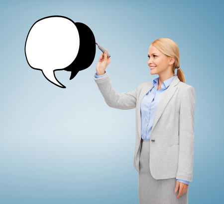 imaginary dialogue: office, business and new technology concept - smiling businesswoman drawing text bubble on virtual screen Stock Photo
