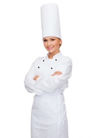 cooking and food concept - smiling female chef with crossed arms photo