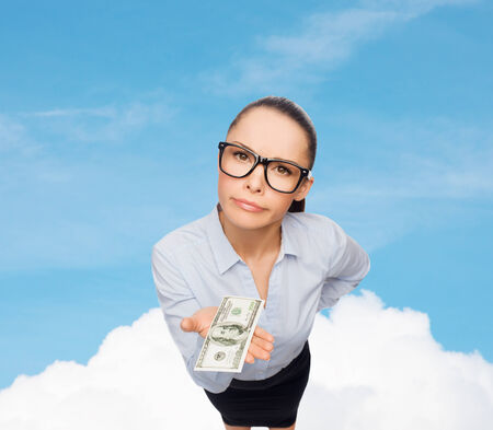 business, money and banking concept - smiling businesswoman in eyeglasses with dollar cash money photo