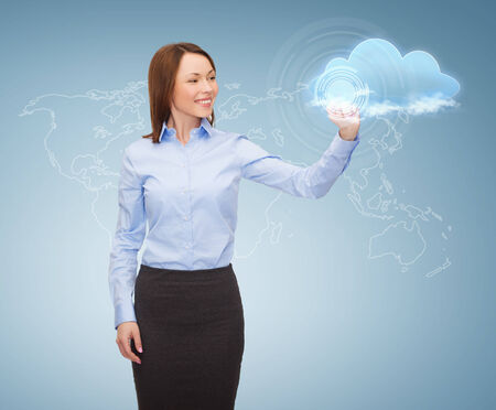 business, cloud computing and future technology concept - young businesswoman working with virtual screen photo