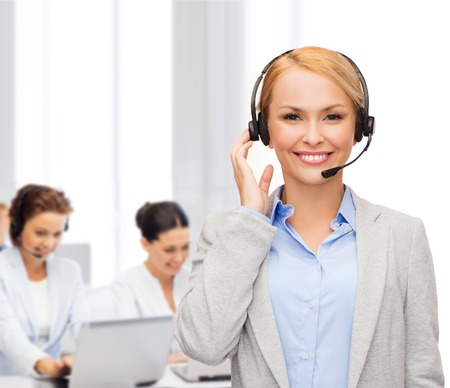 business, technology and call center concept - friendly female helpline operator with headphones at office photo