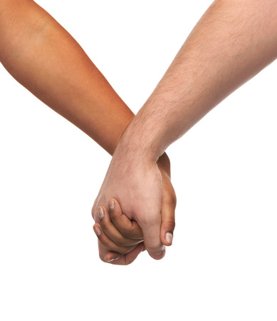 love and relationships concept - closeup of woman and man holding hands photo