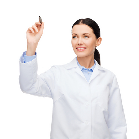 doctor writing: healthcare, medical and technology - young female doctor writing something in the air