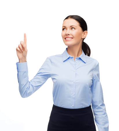 business and new technology concept - attractive young woman with her finger up photo