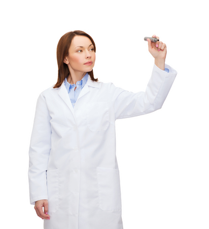 doctor writing: healthcare, medical and technology concept - young female doctor writing something in the air