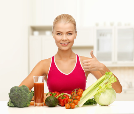 fitness, diet and food concept - young woman with organic food showing thumbs up photo