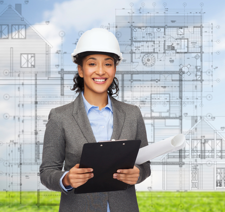 building, developing, consrtuction and architecture concept - smiling businesswoman in white helmet with clipboard and blueprint Stock Photo - 26176180