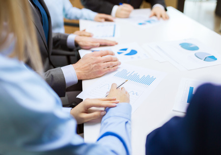 conference meeting: business and office concept - close up of business team with chats and graphs in office Stock Photo