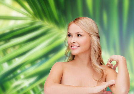 eco sensitive: health and beauty concept - face of beautiful woman touching her shoulder skin Stock Photo