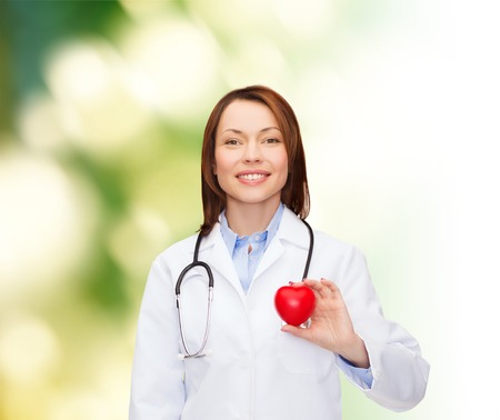 healthcare and medicine concept - smiling female doctor with heart and stethoscope Stock Photo - 26175654