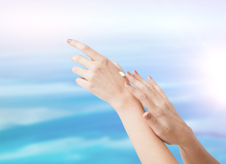body parts, conspetics and spa concept - close up of female soft skin hands with creme