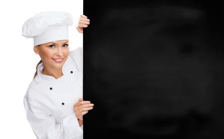 La cuisine, la publicité et le concept de nourriture - souriant femme chef, cuisinier ou boulanger avec le panneau blanc blanc Banque d'images - 26175598