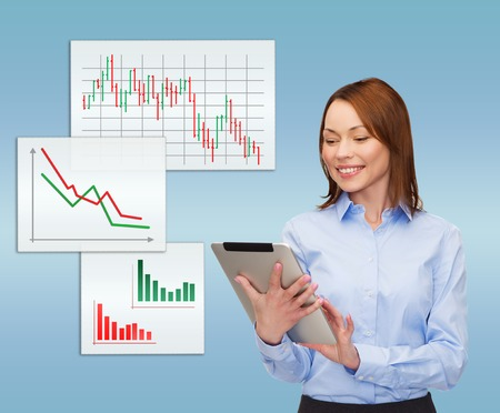 business, internet and technology concept - smiling woman looking at tablet pc computer Stock Photo - 26175581