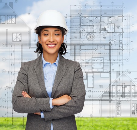 building, developing, consrtuction and architecture concept - smiling businesswoman in white helmet with crossed arms Stock Photo - 26175587