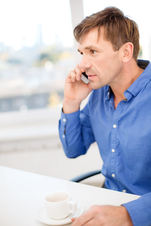 business, communication, modern technology concept - buisnessman with cell phone and cup of coffee Stock Photo - 26175558