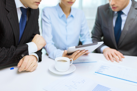 business and office concept - close up of business team with chart, graph, tablet pc and coffee photo