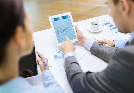 entrepreneurs: business and office concept - close up of business team with graph on tablet pc screen and coffee in office
