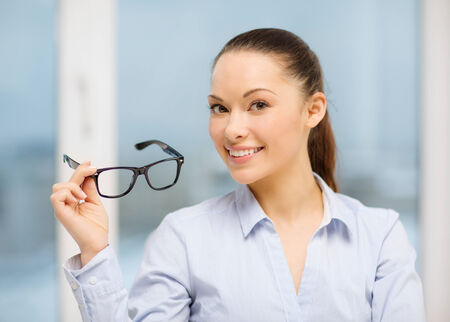 business and education concept - laughing businesswoman with eyeglasses Stock Photo - 26175515