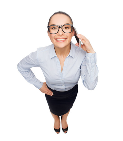 business, technilogy, communication and office concept - smiling businesswoman in eyeglasses with smartphone Stock Photo - 26175517