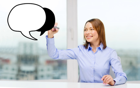 office, business, technology concept - businesswoman drawing blank text bubble photo