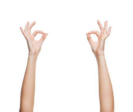 ok sign: gesture and body parts concept - woman hands showing ok sign Stock Photo