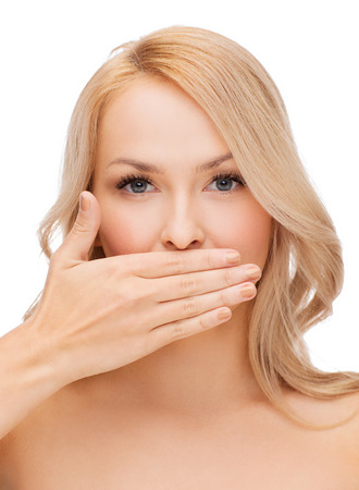 mouth: spa, health and beauty concept - beautiful woman covering her mouth