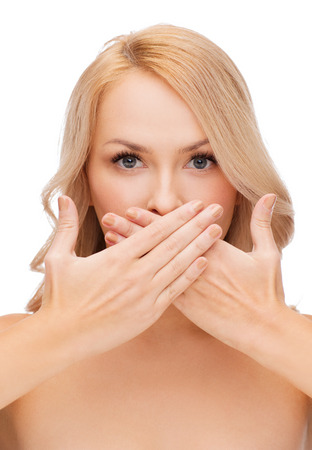 covering the face: spa, health and beauty concept - beautiful woman covering her mouth