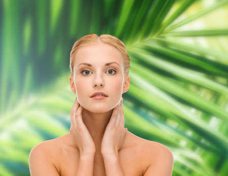 beauty and spa concept - face of beautiful woman touching her face skin Stock Photo