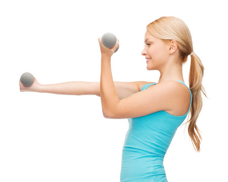 pumping: sport, excercising and healthcare concept - young sporty woman with light dumbbells