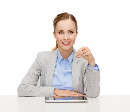 business, technology, internet and office concept - smiling businesswoman with tablet pc computer holding something imaginary photo